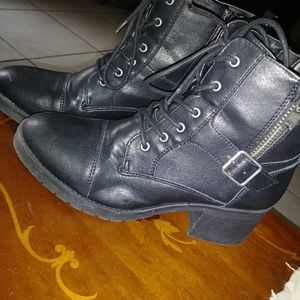 Never worn combat looking boots. Comes with box